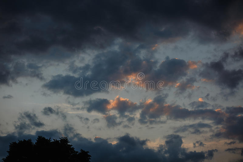 Beautiful sunset sky with bright transitions in color. Beautiful realistic sunset sky with bright transitions in color, splendid screensaver. Sunlight stock images