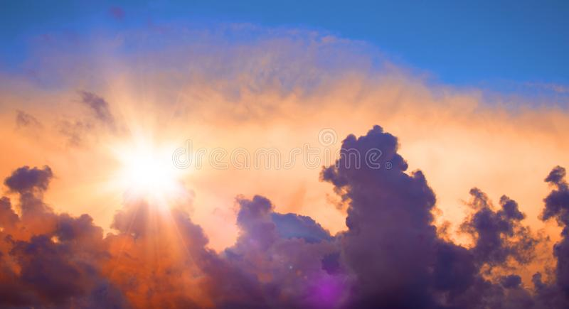 Beautiful sunset sky with clouds. Sun and dramatic light royalty free stock images