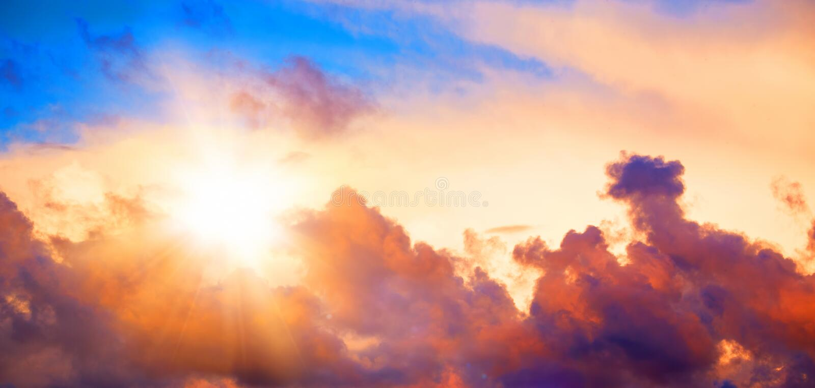 Beautiful sunset sky with clouds. Sun and dramatic light stock photography