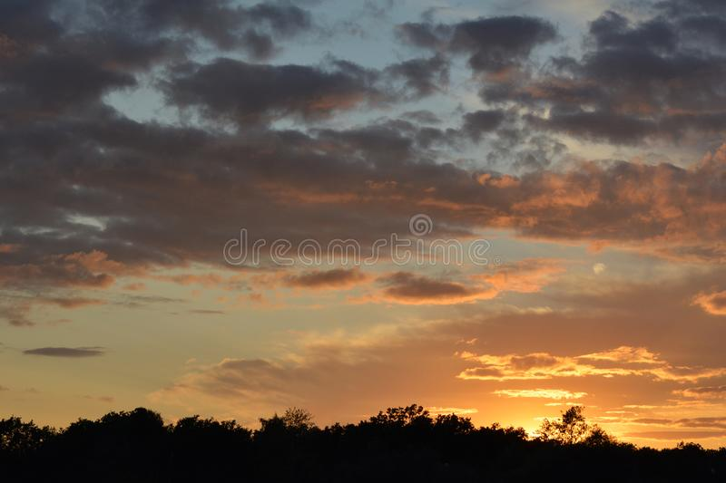 Beautiful sunset sky with dramatic light. Cloudscape in summer evening stock image