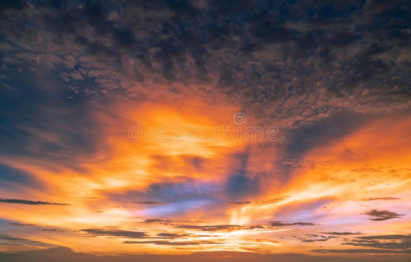 Beautiful sunset sky. Golden and orange sky and clouds with sunbeam. God light concept. Nature background. Power in nature. royalty free stock photos