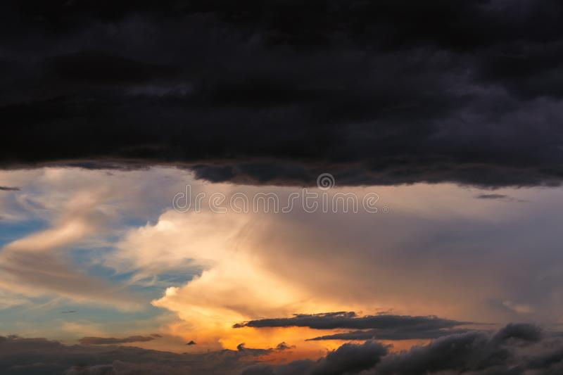 Beautiful sunset sky. Orange, blue, and white sky. Colorful sunrise. Art picture of sky at sunrise. Sunrise and clouds royalty free stock photo