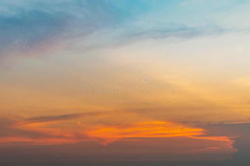 Beautiful sunset sky. Orange, blue, and yellow sky. Colorful sunset. Art picture of sky at sunset. Sunset and clouds. stock images