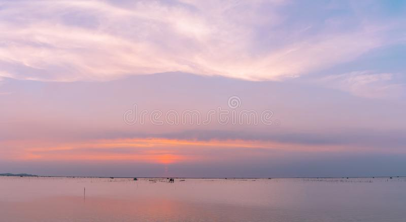 Beautiful sunset sky over the sea in the evening. Blue sky and purple, orange, and white clouds. Dramatic sky and clouds at the royalty free stock photo