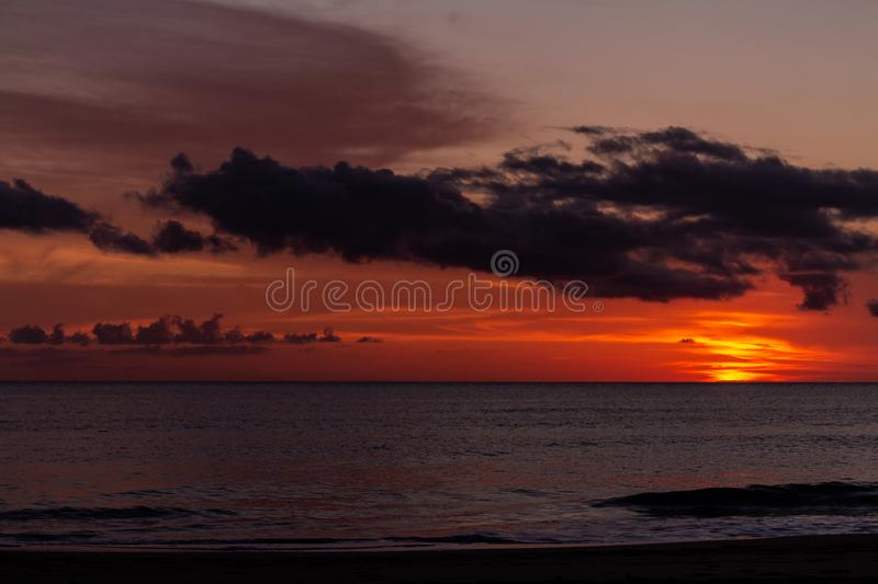 Beautiful sunset with the sky of varied colors. And clouds scattered on the water royalty free stock image