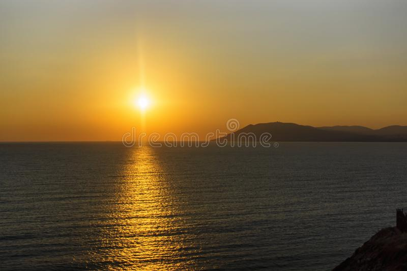Beautiful sunset on smooth Black sea in summer stock image
