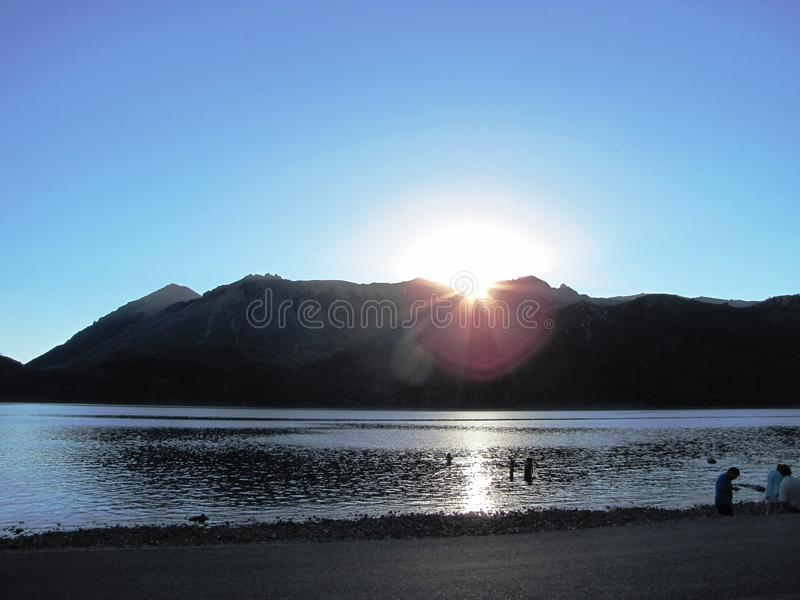Beautiful sunset with the sun behind the mountains in Neuquén, Argentina. stock photography