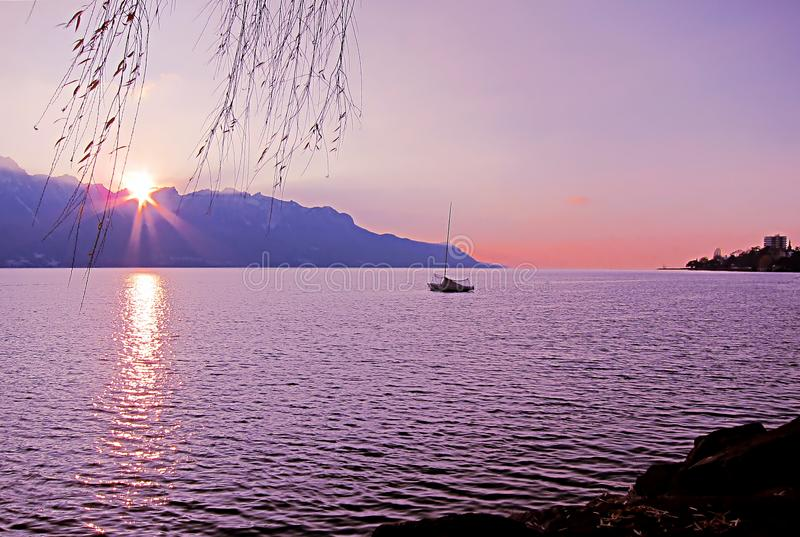 Beautiful sunset over Lake Geneva and the city of Montreux, in S. Beautiful sunset, with sun rays, over Lake Geneva and the city of Montreux, in Switzerland royalty free stock images
