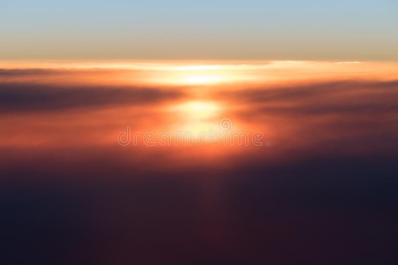 Beautiful sunset or sunrise above clouds from airplane perspective stock photography