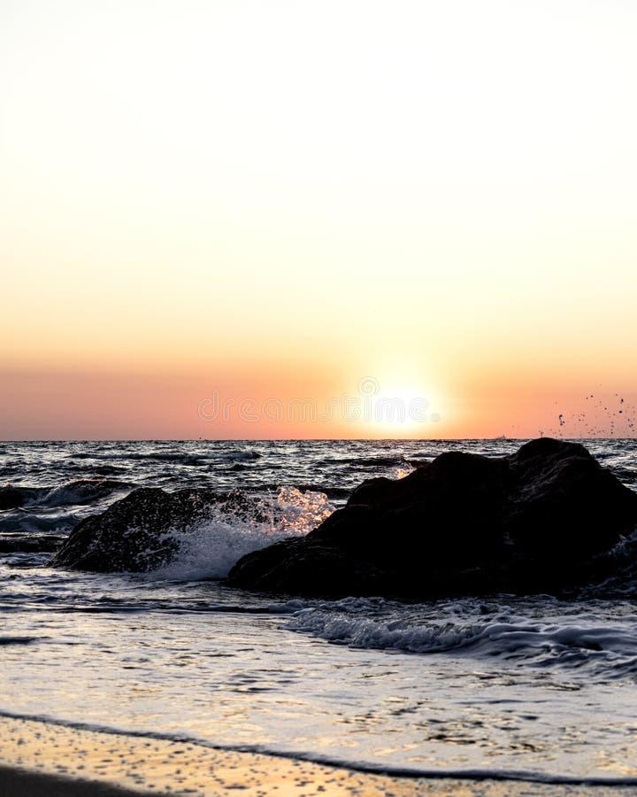 Beautiful sunset sunrise over the sea, beautiful waves. Selective focus stock image