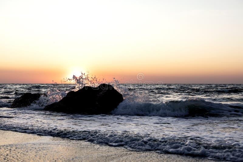Beautiful sunset sunrise over the sea, beautiful waves. Selective focus stock photo