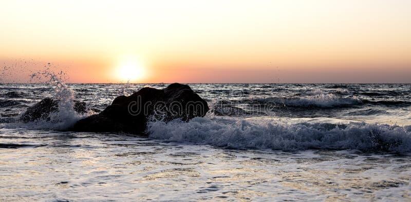 Beautiful sunset sunrise over the sea, beautiful waves. Selective focus royalty free stock image