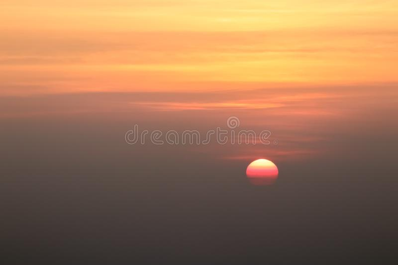 Beautiful sunset or sunrise sky above clouds with dramatic light royalty free stock images