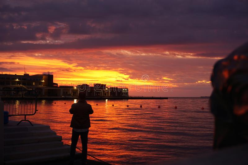 Beautiful sunset in Trieste, Italy. Sky, red, night, sea, reflection, cloudy, clouds stock images