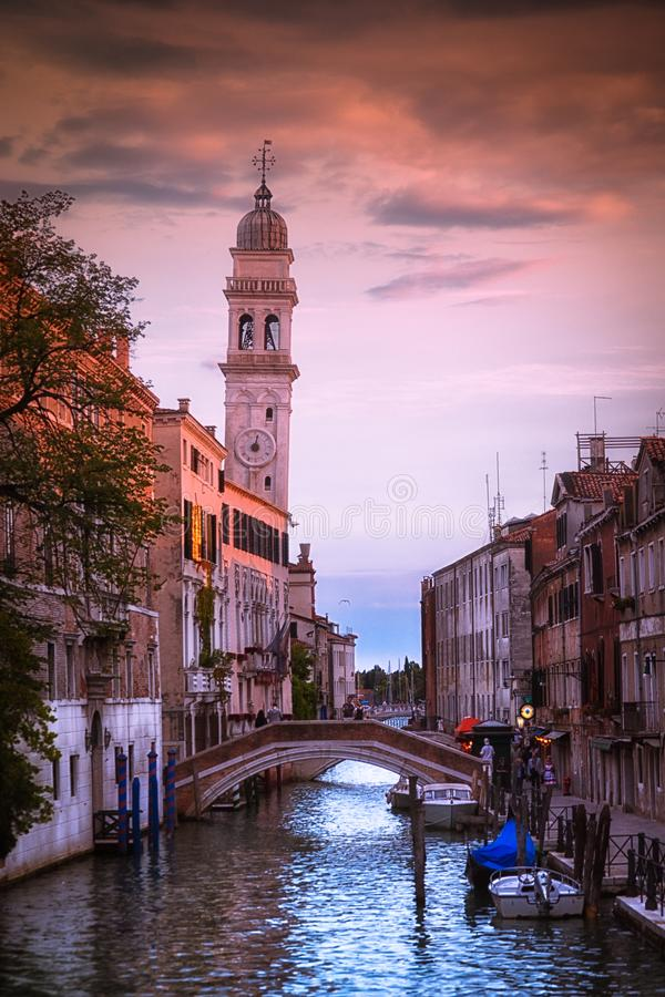 Beautiful sunset in venetian canal, in summer day, Italy royalty free stock images