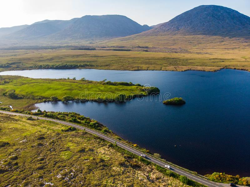 Beautiful sunset view of Connemara. Scenic Irish countryside landscape with magnificent mountains on the horizon, County Galway, I stock photography