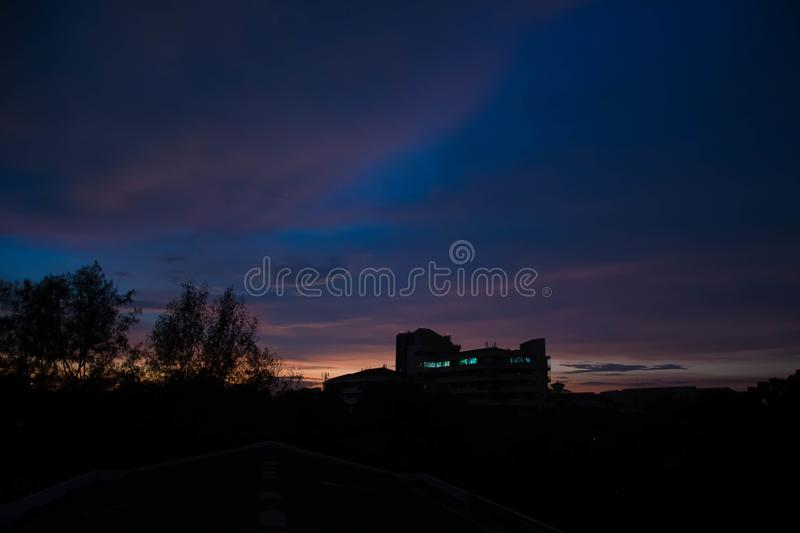 Last shining of the day. Beautiful sunset view from the deck of dorm in university stock images