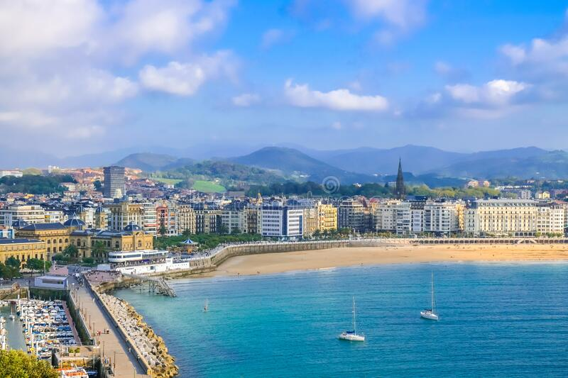 Beautiful sunset view of sandy beach and marina in the city center Donostia San Sebastian in the Bay of Biscay, Basque Country,. Spain stock photos