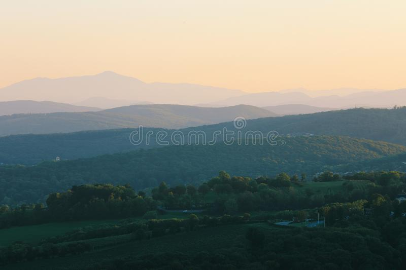 Beautiful sunset with the view of the skyline over the hills royalty free stock photography