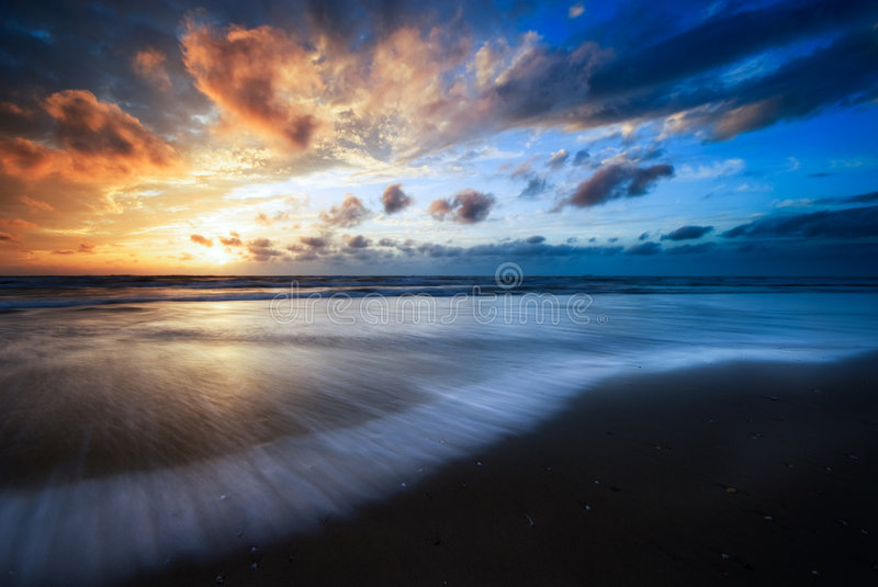 Beautiful sunset and waves stock images