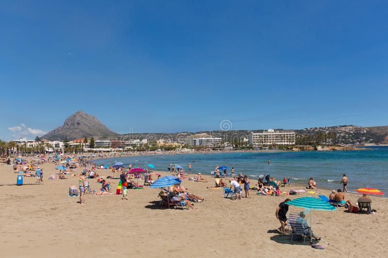 Xabia Spain Playa del Arenal beach in summer with blue sky and sea, also known as Javea. Beautiful sunshine attracted visitors, tourists and holidaymakers to the stock photos