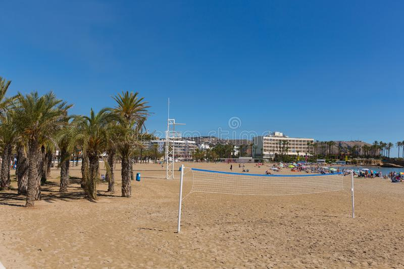 Xabia Spain Playa del Arenal beach wth volleyball net. Beautiful sunshine attracted visitors, tourists and holidaymakers to the sandy Playa del Arenal beach at stock image