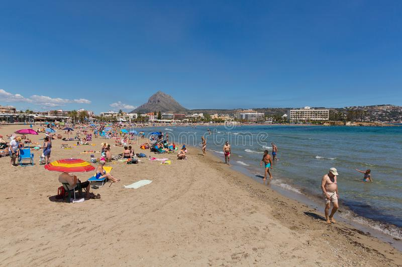 Xabia Spain with beautiful Platja de L`Arenal beach in summer with blue sky and sea, also known as Javea. Beautiful sunshine attracted visitors, tourists and royalty free stock photo