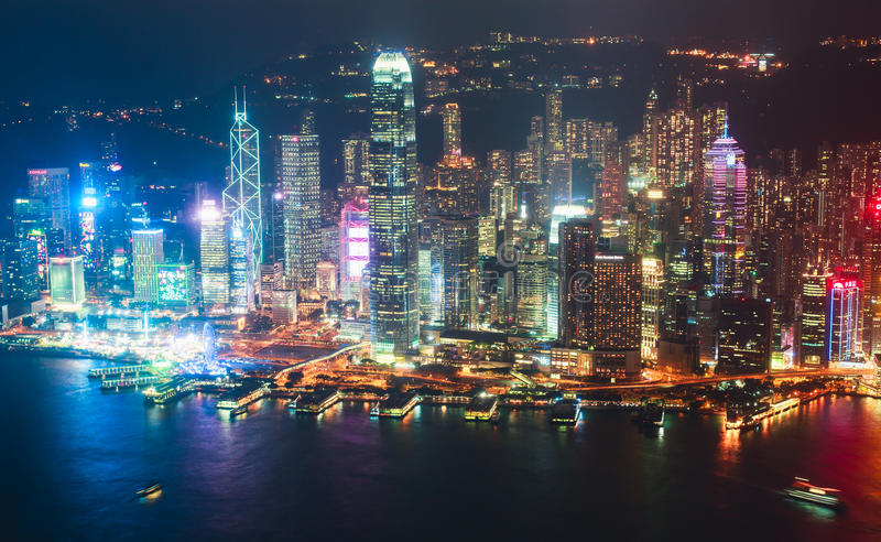 Beautiful super wide-angle summer aerial view of Hong Kong island skyline, Victoria Bay harbor, with skyscrapers, blue sky. Beautiful super wide-angle summer royalty free stock photography