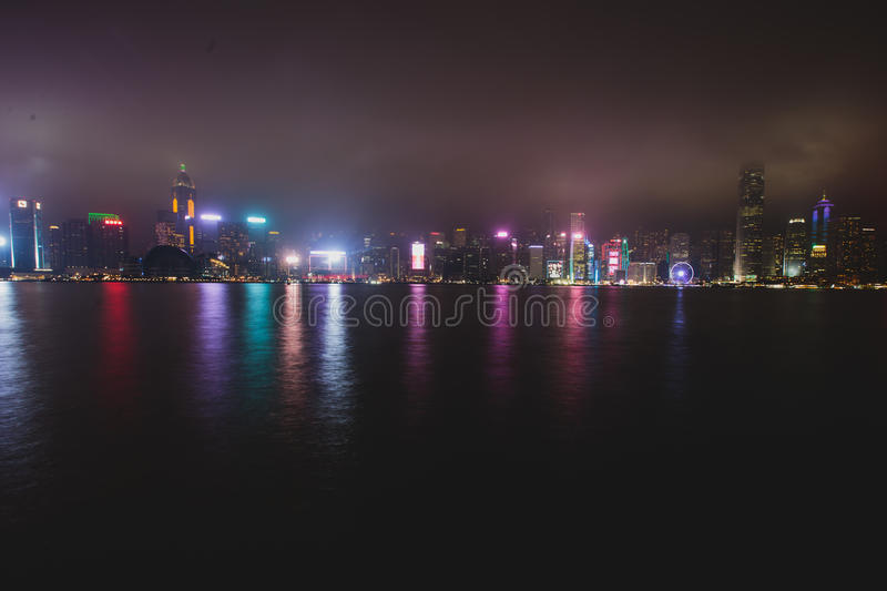 Beautiful super wide-angle summer aerial view of Hong Kong island skyline, Victoria Bay harbor, with skyscrapers, blue sky. Beautiful super wide-angle summer royalty free stock photos