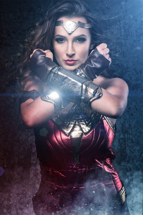 Beautiful superhero woman showing strength stock illustration