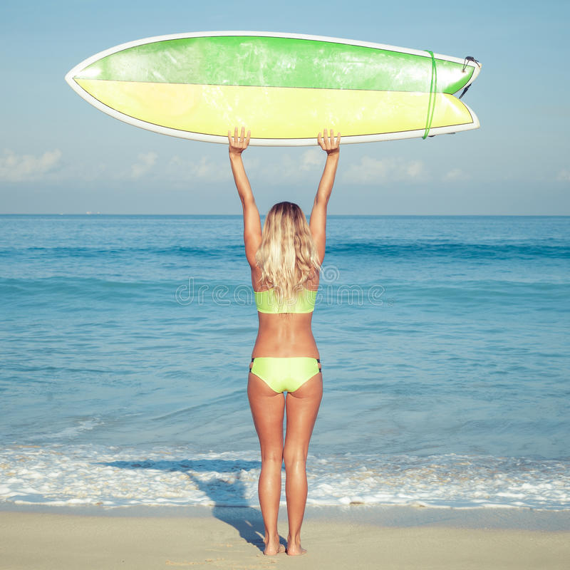 Beautiful Surfer Girl on the Beach stock photos