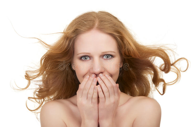 Beautiful surprised woman with flowing hair. Beautiful surprised young woman with flowing hair shocked open mouth closes hands isolated on a white background stock photos