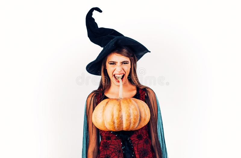 Beautiful surprised woman in witches hat and costume. Halloween Woman portrait. Happy gothic young woman in witch stock image