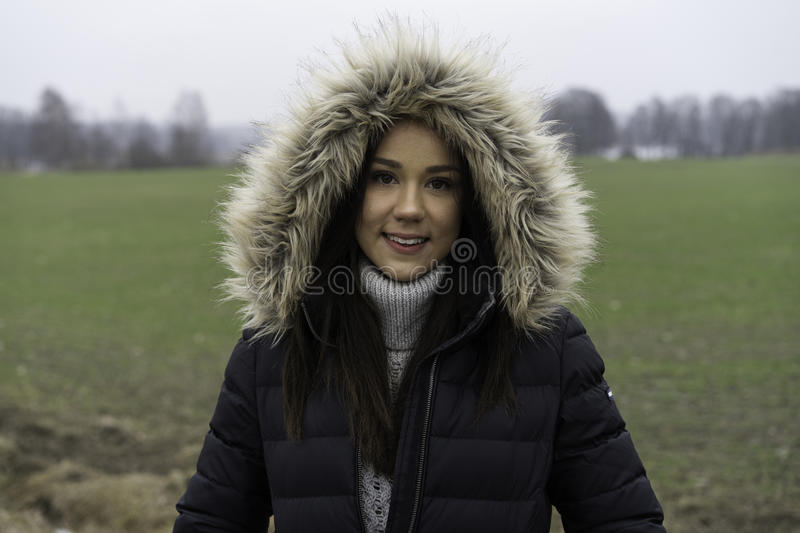 Beautiful Swedish caucasian teen girl. Beautiful Swedish caucasian lifestyle and fashion teen girl standing outdoors. Cloudy day in winter landscape. Wearing royalty free stock photography