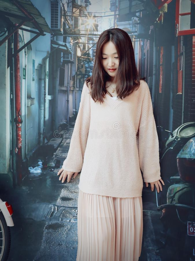 Beautiful sweet Chinese girl in an old alley of shanghai stock image