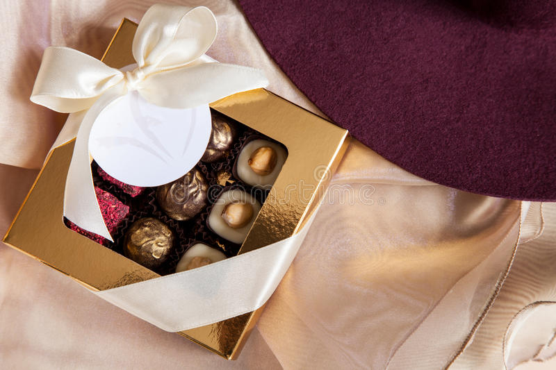 Beautiful sweets in the gift box and an empty card -. Closeup shot stock photo