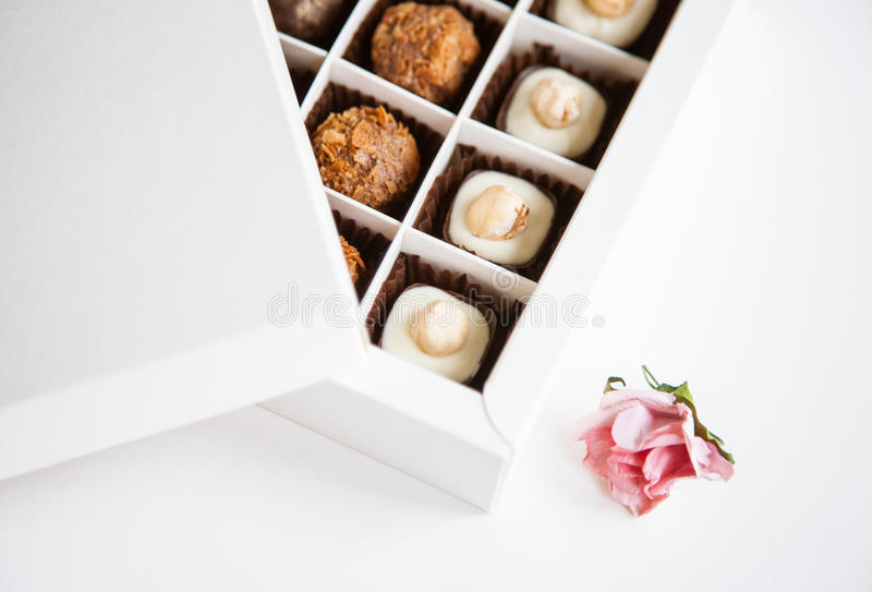 Beautiful sweets in the gift box. On white background stock image