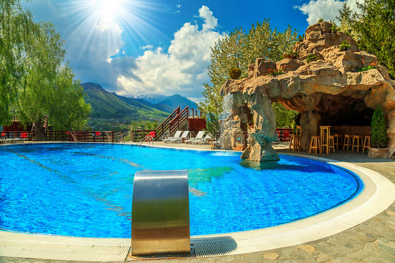 Beautiful Swimming Pool With Beach Bar And Waterfall Stock ...