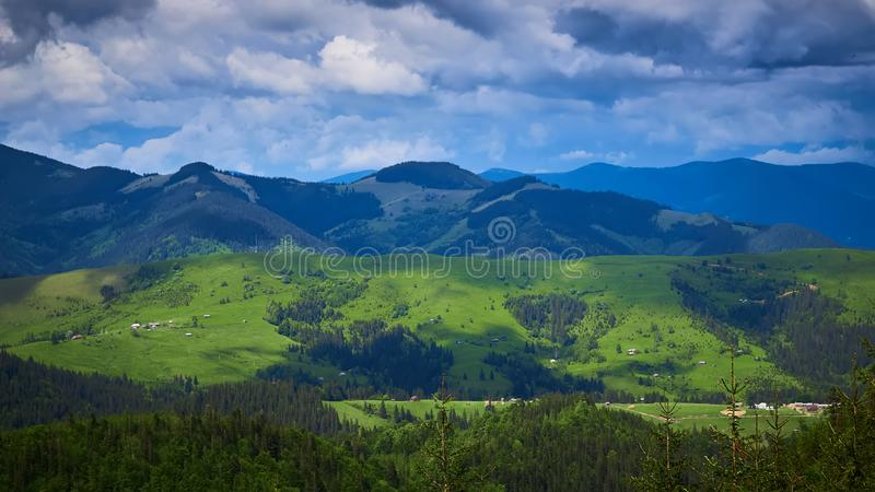 Beautiful swiss alps. Amazing mountain view with high peaks, green hills and clouds low in the valley stock images