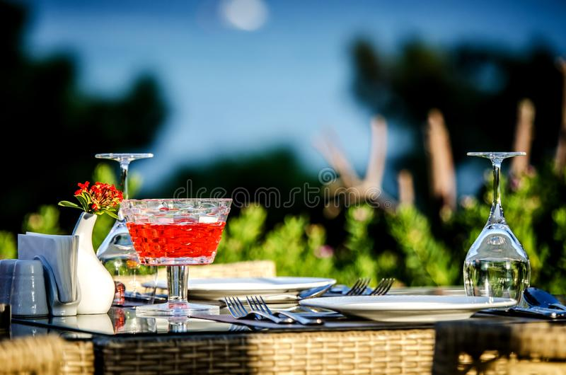 A beautiful table setting before dinner in a restaurant by the sea. royalty free stock photography