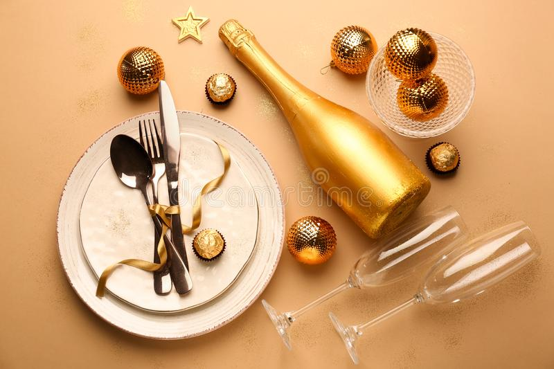 Beautiful tableware with champagne on color background royalty free stock photos