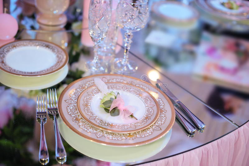 Beautiful tableware in the restaurant for a wedding banquet.  royalty free stock photography