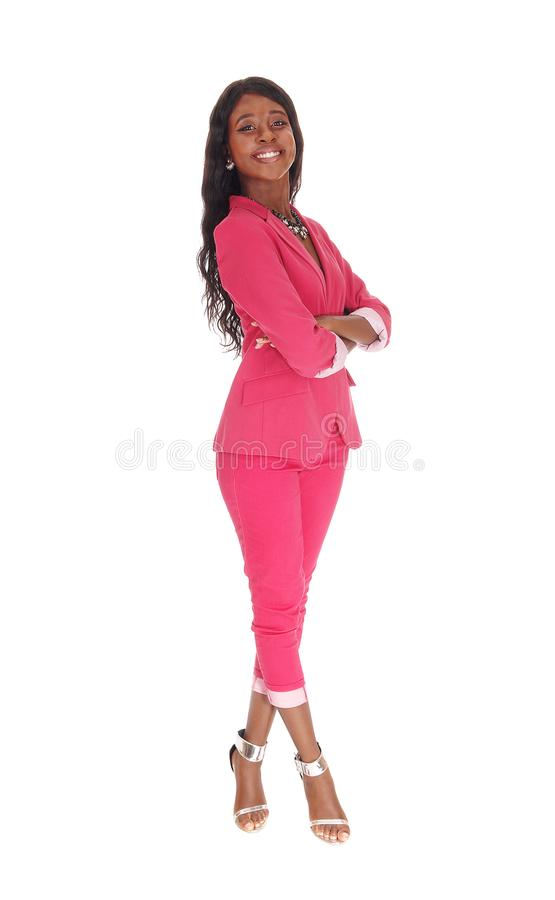 Beautiful tall African woman standing in a pink suit royalty free stock photography