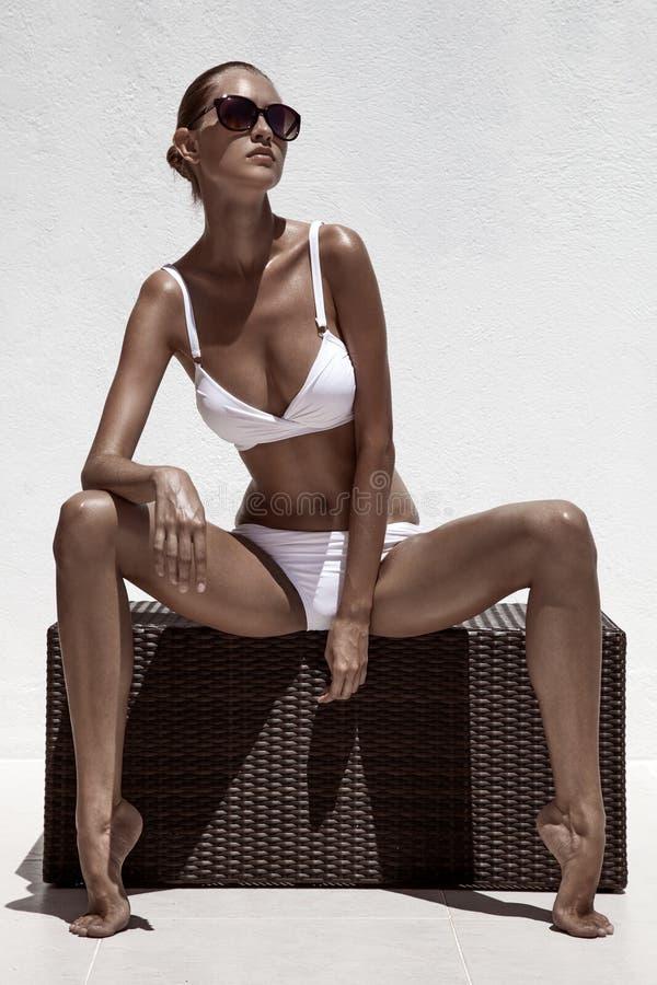Beautiful tan female model posing stock images
