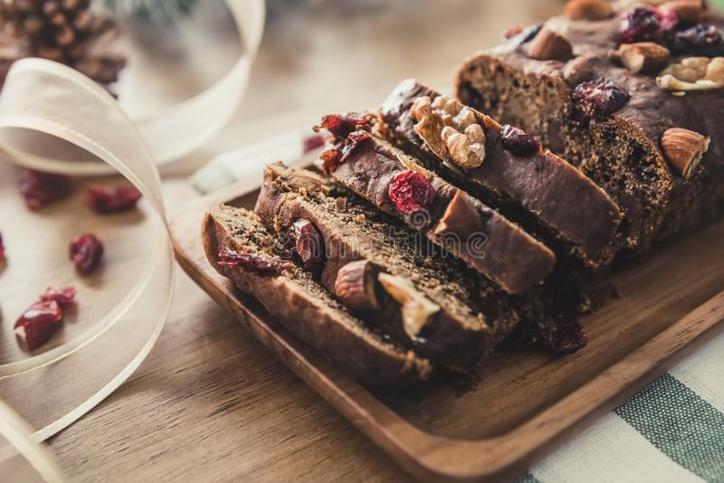 Beautiful tasty dried mixed nut Christmas fruit cake on wooden t stock images
