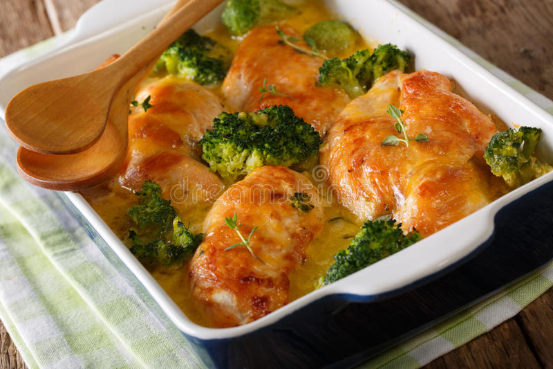 Beautiful and tasty food: Chicken fillet and broccoli baked in c stock image
