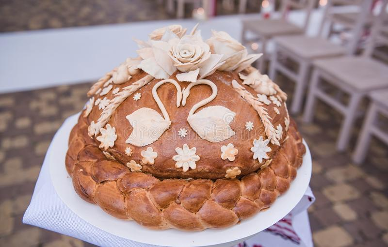 Beautiful and tasty wedding loaf. The loaf decorated with flowers and birds for wedding tradition stock photography
