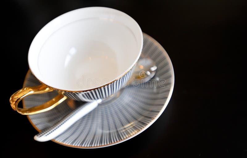 Beautiful teacup. A beautiful teacup with golden decoration royalty free stock photos