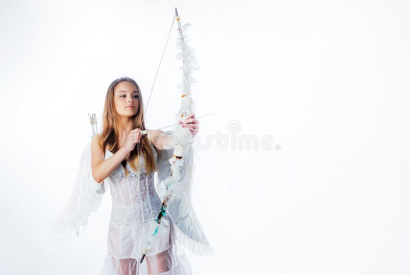 Beautiful teen with blonde curly hair and a bow and arrow as cupid - Valentines Day. Sweet angel girl - copy space. Teen royalty free stock photography
