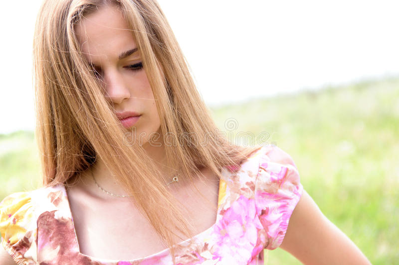 Beautiful teen girl with concerned expression royalty free stock photos